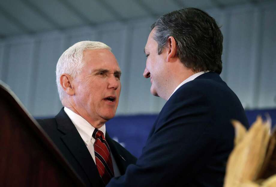 "In the past, Texas Sen. Ted Cruz, right, has sidestepped saying Donald Trump's name during his tour to bolster Republicans in toss-up races, but he hit the campaign trail to try to avert the ""absolute disaster"" of a Hillary Clinton presidency.  Photo: Charlie Neibergall, STF / Copyright 2016 The Associated Press. All rights reserved."