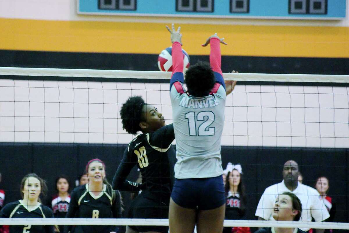 Porter's Shelby WilliamsÊ(10) goes face-to-face with Manvel's Delaine Fulton (12) at the net Thursday, Nov. 3 at Pasadena Memorial High School.