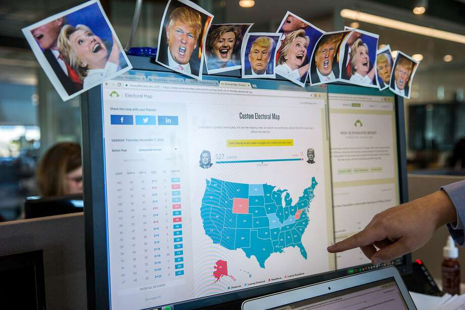 Jon Cohen points to a SurveyMonkey electoral map on Thursday in Palo Alto. The company's influence in election polling has grown dramatically. Photo: Santiago Mejia, The Chronicle