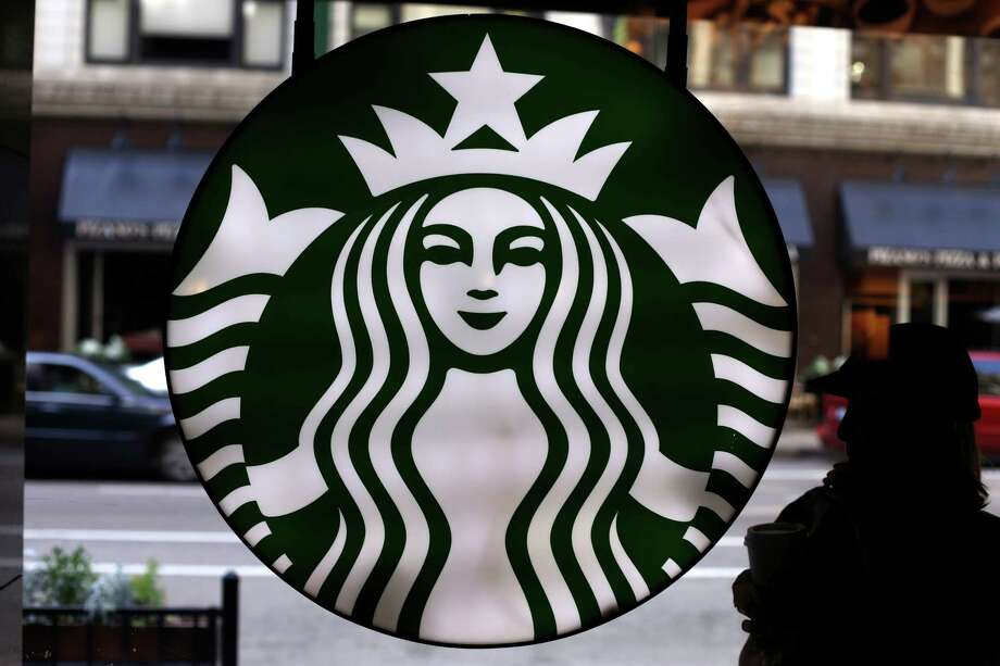 FILE - This Saturday, May 31, 2014, file photo, shows the Starbucks logo at one of the company's coffee shops in downtown Chicago. Starbucks reports financial results Thursday, Nov. 3, 2016. (AP Photo/Gene J. Puskar, File) ORG XMIT: NYBZ402 Photo: Gene J. Puskar / Copyright 2016 The Associated Press. All rights reserved.