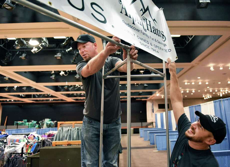 Douglas Weiderman, left, and Matt Aldi hang an Alpin Haus banner for this weekend's the Northeast Ski & Craft Beer Showcase at the Empire State Plaza Convention Center Thursday Nov. 3, 2016 in Albany, NY.  (John Carl D'Annibale / Times Union) Photo: John Carl D'Annibale / 20038672A