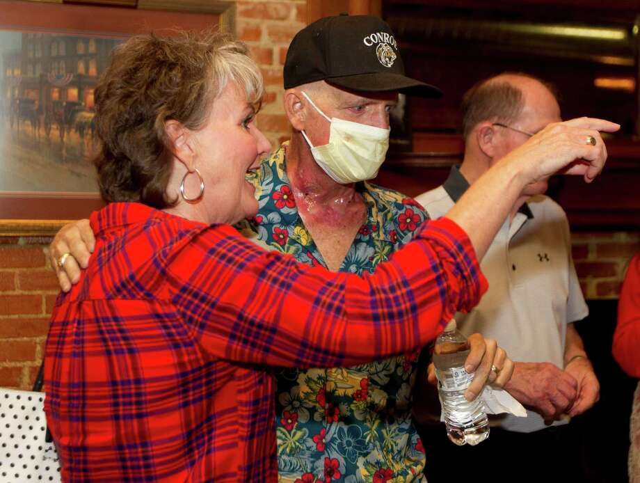 Kam Hutchins, center, visits with Jo Ann Beken, former principal at Hauke High School, to Montgomery County Sheriff Rand Henderson during Hutchins' 55th birthday party at Martiné•s Hall Thursday, Nov. 3, 2016, in Conroe. The event also served as a medical fundraiser for Hutchins, a retired teacher at Hauke and 1980 graduate of Conroe High School, who is battling tonsil cancer. Photo: Jason Fochtman, Staff Photographer / Houston Chronicle