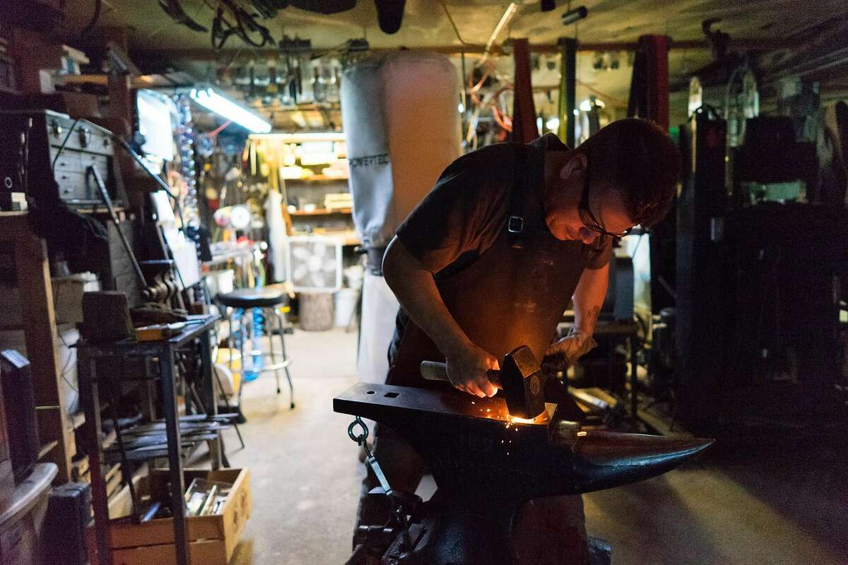 Drew Hash works on a knife at his home in San Francisco, Calif. on Thursday, Nov. 3, 2016. Hash is a former restaurant chef who makes knives in his Potrero Hill garage.
