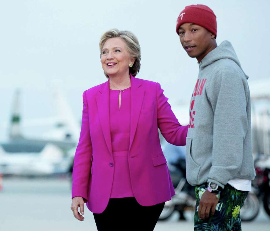 Democratic candidate Hillary Clinton,with music artist Pharrell Williams, is trying to make headway in North Carolina, where black voter participation has idled. Photo: Andrew Harnik, STF / Copyright 2016 The Associated Press. All rights reserved.