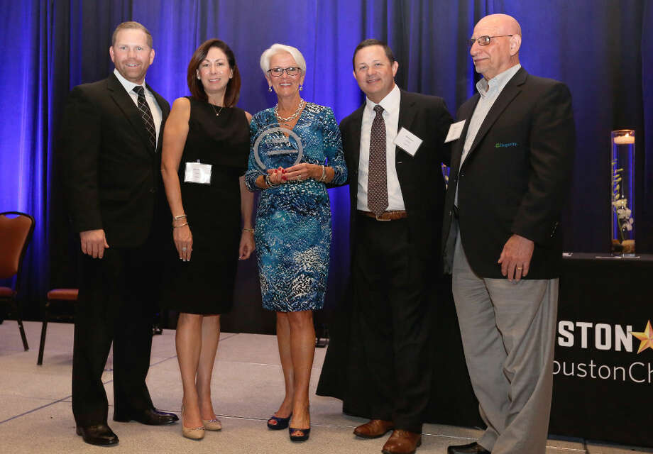 Insperity representatives show the company's Top Workplaces Award in Houston on Thursday. Photo: Yi-Chin Lee, Chronicle