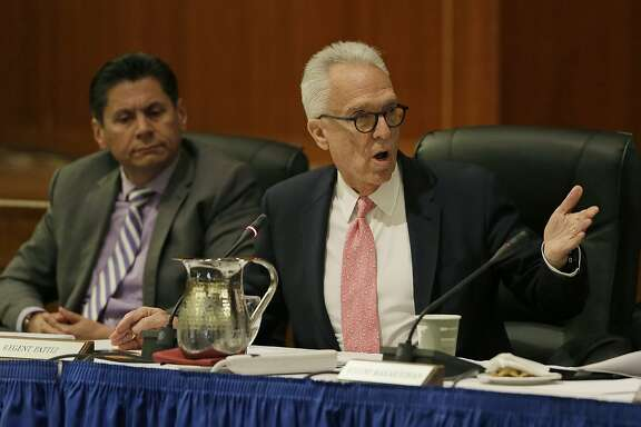 "File - In this March 23, 2016 file photo, Norman J. Pattiz, right, speaks as Eloy Ortiz Oakley, left, looks on during a University of California Board of Regents meeting in San Francisco. Regent Pattiz has apologized to a former employee for asking to hold her breasts while she taped a bra commercial. Pattiz said he ""deeply regrets"" the comments and won't repeat such behavior. Pattiz is chairman of the Courtside Entertainment Group, which produces radio shows and podcasts. (AP Photo/Eric Risberg, File)"