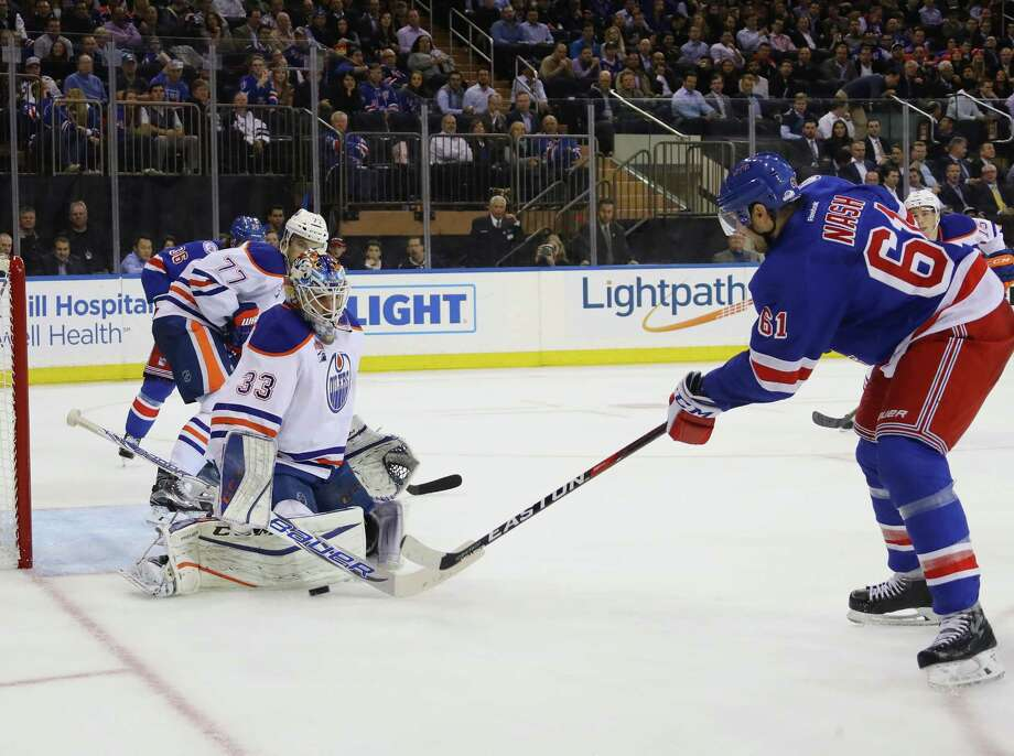 NEW YORK, NY - NOVEMBER 03: Cam Talbot #33 of the Edmonton Oilers makes the second period stop on Rick Nash #61 of the New York Rangers at Madison Square Garden on November 3, 2016 in New York City.  (Photo by Bruce Bennett/Getty Images) ORG XMIT: 672869147 Photo: Bruce Bennett / 2016 Getty Images
