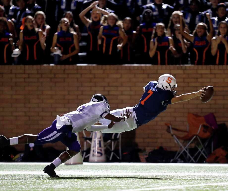 Seven Lakes quarterback Michael Batton dives for the end zone ahead of Morton Ranch safety Deandre Allen to score on a 52-yard run. Photo: Karen Warren, Staff Photographer / 2016 Houston Chronicle