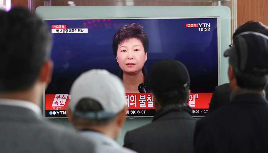 "People watch a TV screen showing the live broadcast of South Korean President Park Geun-hye's address to the nation, at the Seoul Railway Station in Seoul, South Korea, Friday, Nov. 4, 2016. Park took sole blame Friday for a ""heartbreaking"" scandal that threatens her government and vowed she will accept a direct investigation into her actions amid rising suspicion that she allowed a mysterious confidante to manipulate power from the shadows. (AP Photo/Lee Jin-man) ORG XMIT: LJM103 Photo: Lee Jin-man / Copyright 2016 The Associated Press. All rights reserved."