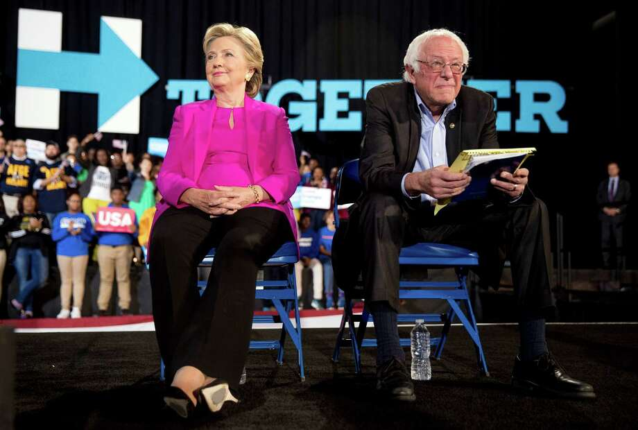 Democratic presidential candidate Hillary Clinton and Sen. Bernie Sanders, D-Vt., appear at a rally at Coastal Credit Union Music Park at Walnut Creek in Raleigh, N.C., Thursday, Nov. 3, 2016. (AP Photo/Andrew Harnik) ORG XMIT: NCAH131 Photo: Andrew Harnik / Copyright 2016 The Associated Press. All rights reserved.