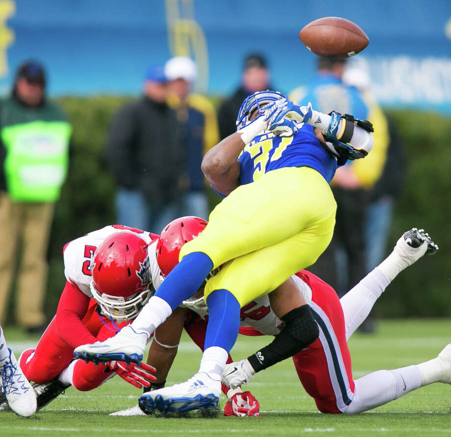 Stony Brook defensive back Kye Morgan (23) and linebacker Shayne Lawless (35) put a hit on Delaware running back Wes Hills, who fumbles the ball, during an NCAA college football game at Delaware Stadium in Newark, Del., Saturday, Oct. 22, 2016. (Suchat Pederson/The Wilmington News-Journal via AP) ORG XMIT: DEWIL209 Photo: Suchat Pederson / The Wilmington News-Journal