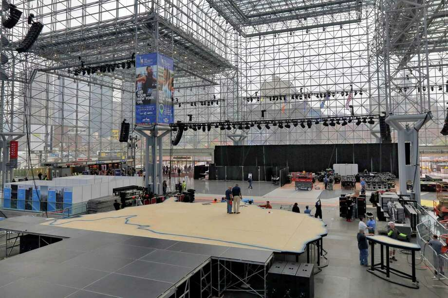 "Workers prepare Democratic presidential candidate Hillary Clinton's election night venue, inside the Jacob K. Javits Convention Center, in New York, Thursday, Nov. 3, 2016. New York City is preparing for an election night like few others in its history, with both candidates planning ""victory"" parties about a mile apart in midtown Manhattan. (AP Photo/Richard Drew) ORG XMIT: NYRD104 Photo: Richard Drew / AP"