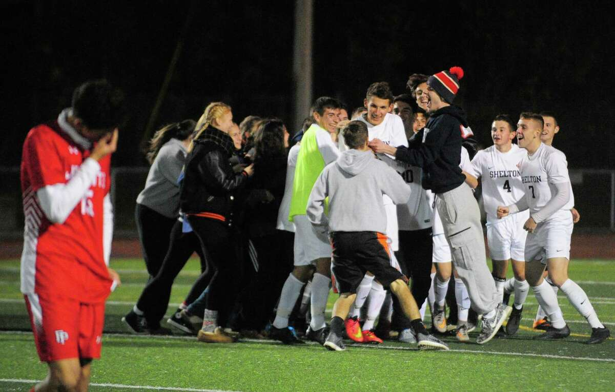 Shelton celebrates its win over Fairfield Prep after SCC soccer championship action in West Haven, Conn. on Thursday Nov. 3, 2016.