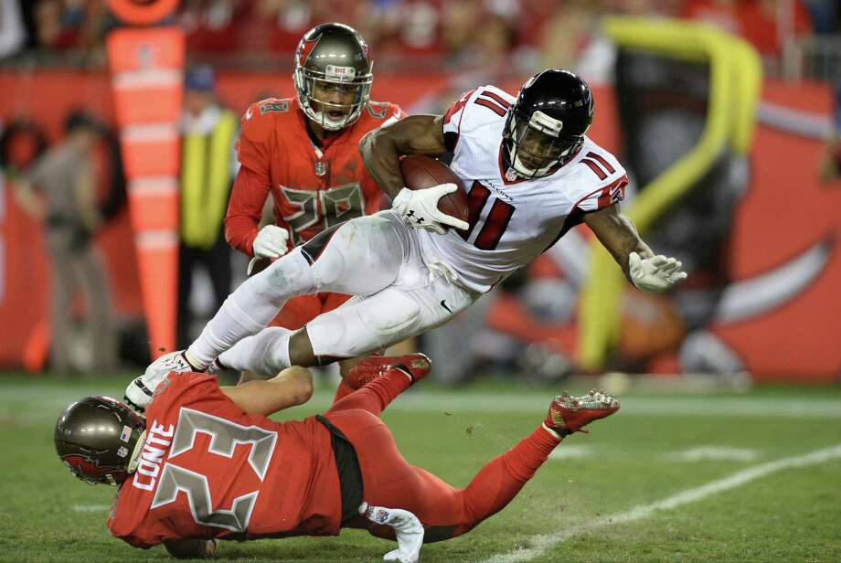 Atlanta Falcons wide receiver Julio Jones (11) is stopped by Tampa Bay Buccaneers strong safety Chris Conte (23) after a reception during the second half of an NFL football game in Tampa, Fla., Thursday, Nov. 3, 2016. (AP Photo/Jason Behnken) ORG XMIT: TPS208 Photo: Jason Behnken / FR171457 AP