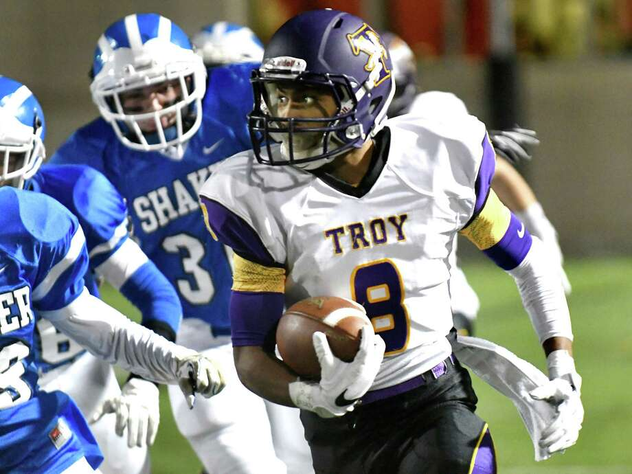 Troy's Dev Holmes, right, runs for a touchdown at the start of their Class AA Super Bowl against Shaker on Thursday, Nov 3, 2016, at East Campus Stadium in Troy, N.Y. (Cindy Schultz / Times Union) Photo: Cindy Schultz / Albany Times Union