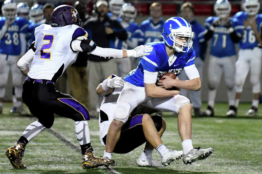 Shaker's Nick Pepe, right, fights off Troy defenders Nick Pastore, left, and Matt Ashley during their Class AA Super Bowl on Thursday, Nov 3, 2016, at East Campus Stadium in Troy, N.Y. (Cindy Schultz / Times Union) Photo: Cindy Schultz / Albany Times Union