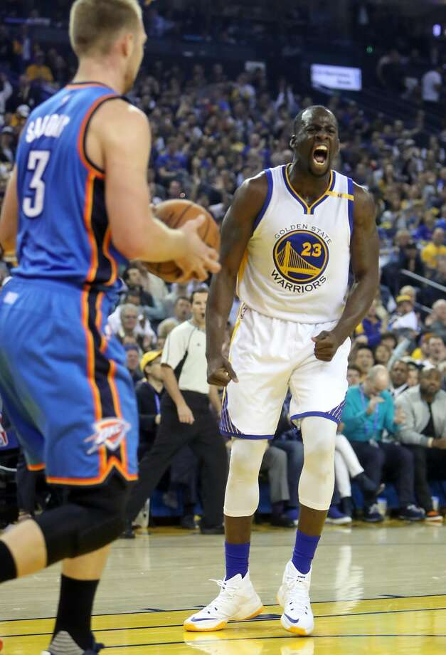 Golden State Warriors' Draymond Green emotes after scoring a basket against Oklahoma City Thunder's Domantas Sabonis in 1st quarter during NBA game at Oracle Arena in Oakland, Calif., on Thursday, November 3, 2016. Photo: Scott Strazzante, The Chronicle