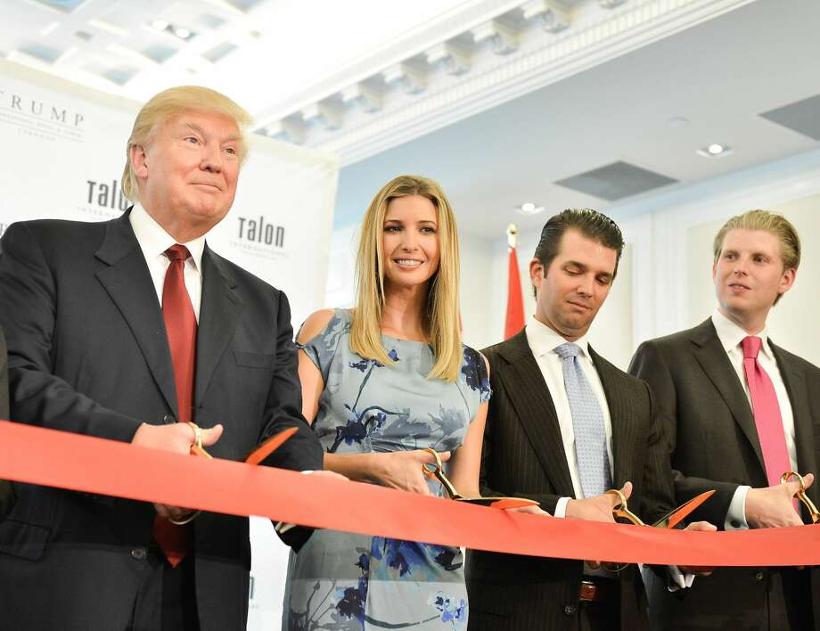Future President Donald Trump and offspring Ivanka Trump, Donald Trump Jr. and Eric Trump attend the Grand Opening Ribbon Cutting Ceremony at the Trump International Hotel and Tower in Toronto. The money-losing tower has been sold and the Trump name is being taken off.  Photo: George Pimentel/WireImage