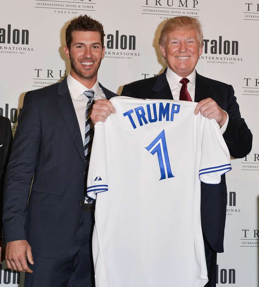 Toronto Blue Jays player J.P. Arencibia and Donald Trump attend the Grand Opening Ribbon Cutting Ceremony at the Trump International Hotel and Tower Toronto on April 16, 2012 in Toronto. Photo: George Pimentel/WireImage