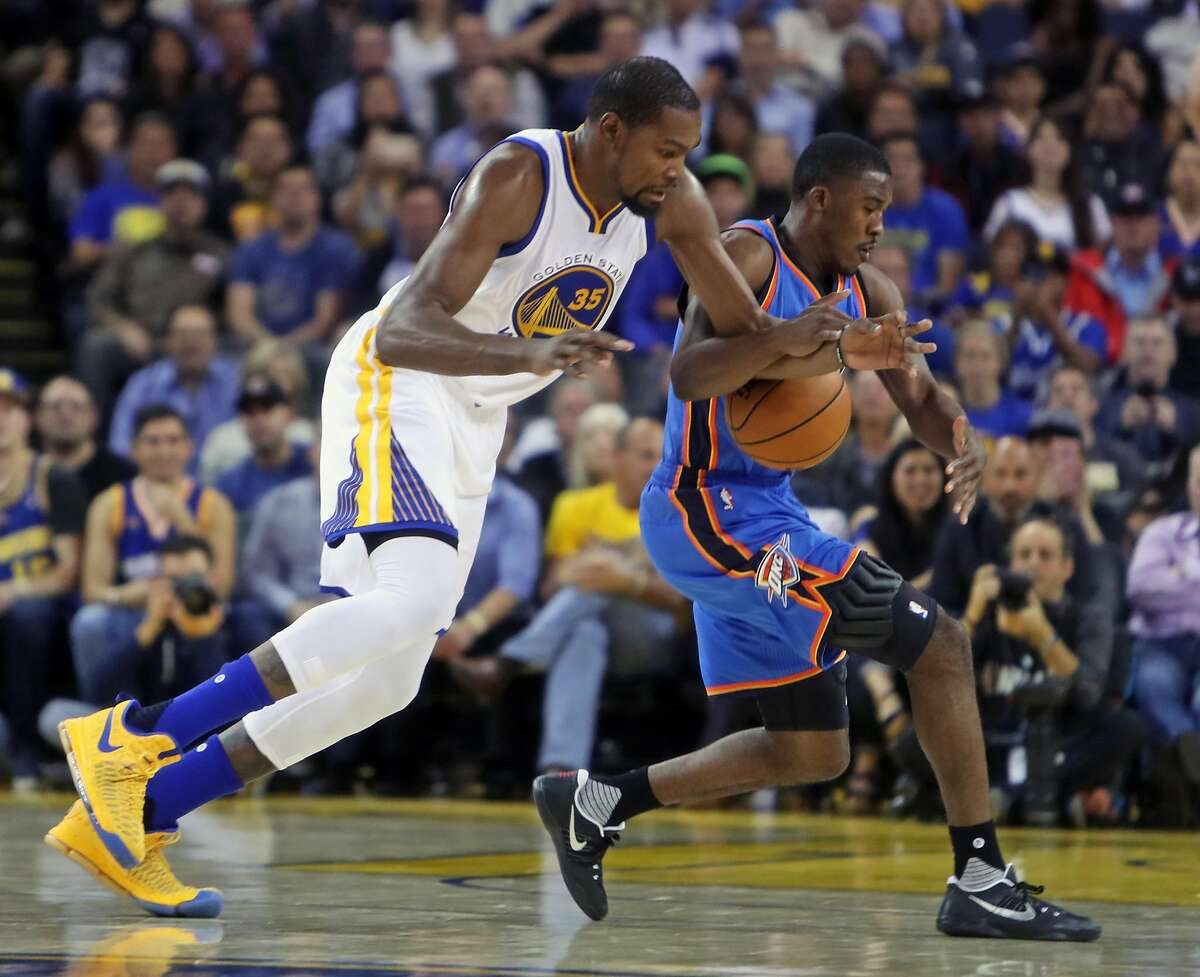 Golden State Warriors' Kevin Durant gets tangled up with Oklahoma City Thunder's Semaj Christon in 4th quarter of Warriors' 122-96 win during NBA game at Oracle Arena in Oakland, Calif., on Thursday, November 3, 2016.
