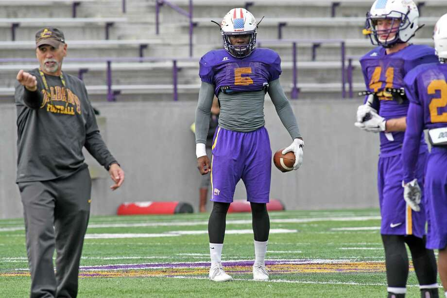 UAlbany football safety Adegboyega Asanpaola, center, during practice on Wednesday Nov. 2, 2016 in Albany, N.Y.  (Michael P. Farrell/Times Union) Photo: Michael P. Farrell / 20038635A