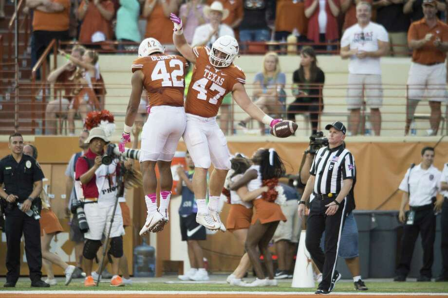 Andrew Beck (47) celebrates with TExas teammate Caleb Bluiett after scoring a touchdown on a 7-yard reception against the Baylor Bears during the second half on Oct. 29, 2016, in Austin. Photo: Cooper Neill /Getty Images / 2016 Getty Images