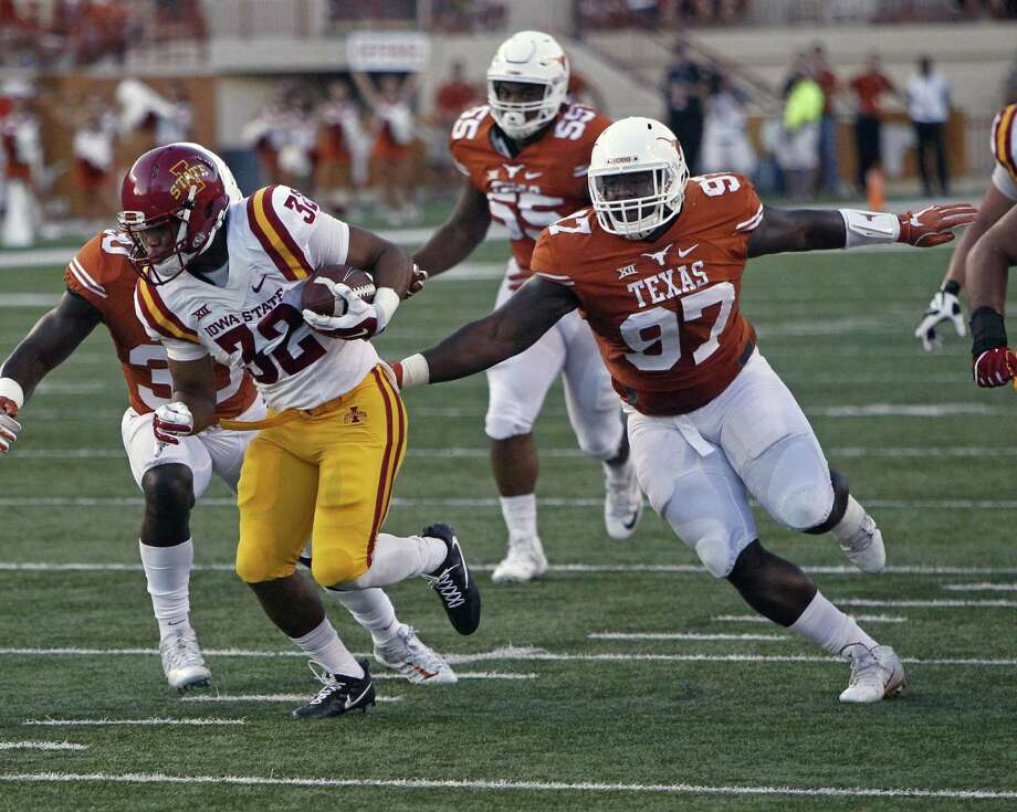 Texas' Chris Nelson (97) pursues Iowa State's David Montgomery during the first half on Oct. 15, 2016, in Austin. Photo: Michael Thomas /Associated Press / FR65778 AP