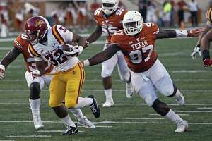 Texas' Chris Nelson (97) pursues Iowa State's David Montgomery during the first half on Oct. 15, 2016, in Austin.
