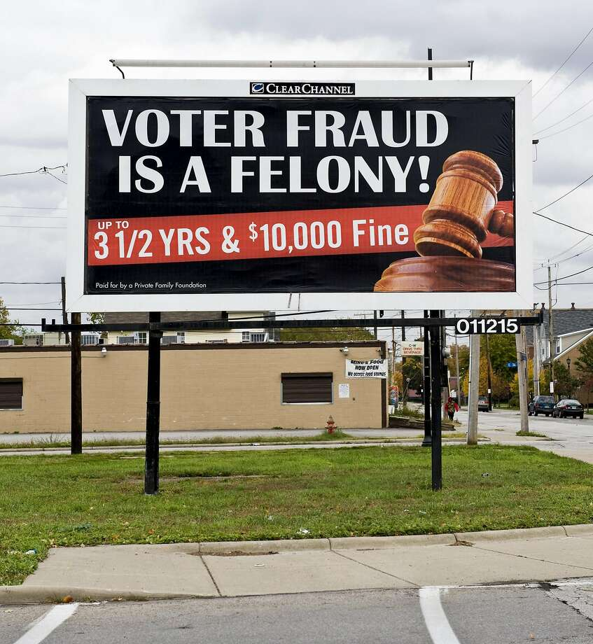 A sign threatens criminal prosecution for voter fraud. Democrats argue the GOP is practicing voter intimidation. Photo: Brian Cahn, TNS