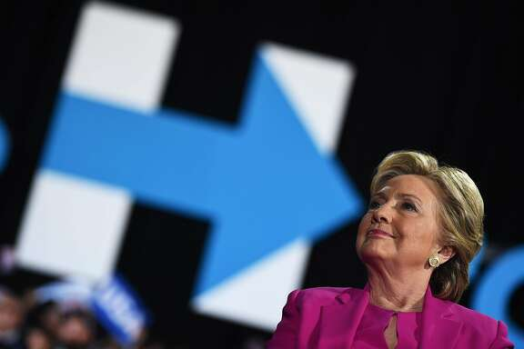 TOPSHOT - US Democratic presidential nominee Hillary Clinton speaks during a campaign rally in Raleigh, North Carolina, on November 3, 2016.   / AFP PHOTO / JEWEL SAMADJEWEL SAMAD/AFP/Getty Images