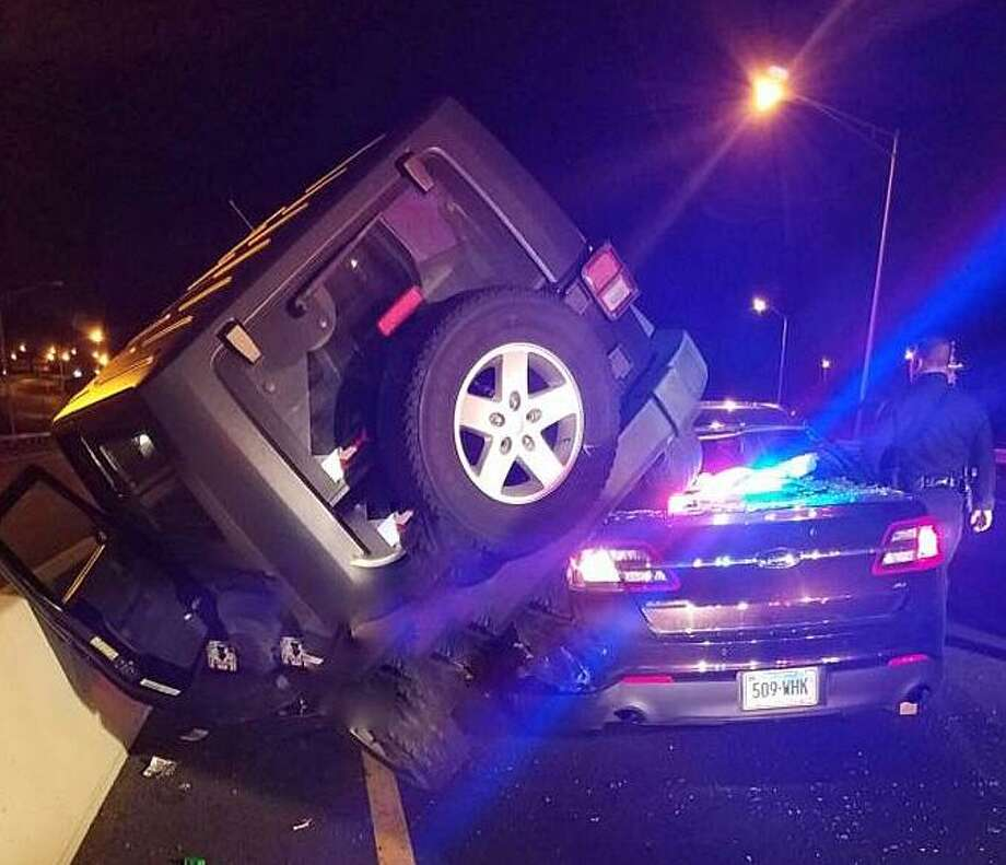 A veteran state police detective was injured after a a drunk driver slammed into his cruiser on Thursday, Nov. 3, 2016. Michael Gauvin, 43, of East Hartford, hit the cruiser after side-swiping a DOT truck. Gauvin was charged with driving under the influence, failure to maintain proper Lane and failure to slow down and move over for emergency vehicles. Photo: Connecticut State Police