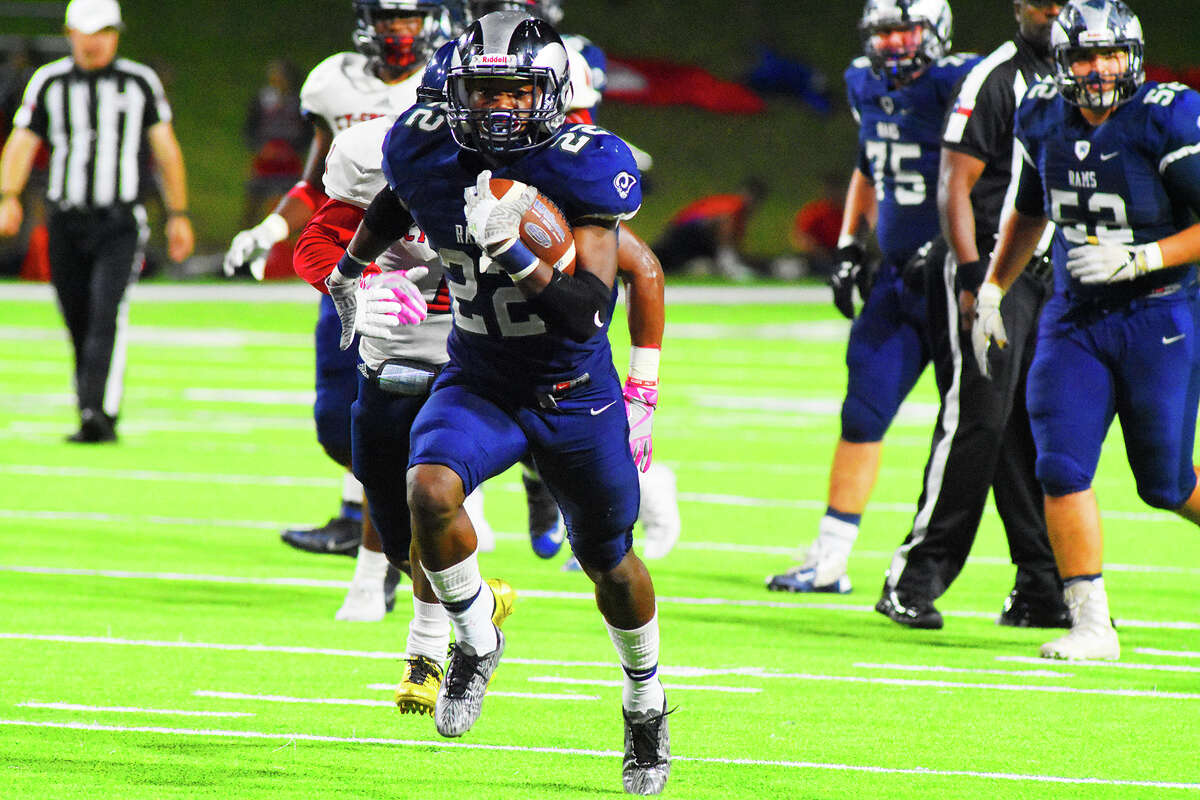 Cy Ridge senior rusher Trelon Smith flies upfield for a touchdown against Cy Springs. Smith was no stranger to the end zone Thursday night, scoring four times on three rushes and one kick return. Smith finished the game with 356 all-purpose yards.