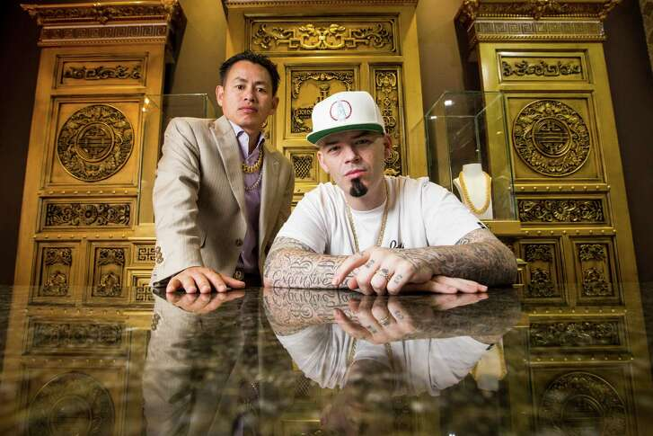 Houston rapper Paul Wall and jeweler Johnny Dang in the VIP area of the new custom grillz store, Johnny Dang & Co., Tuesday, Oct. 25, 2016 in Houston. ( Michael Ciaglo / Houston Chronicle )