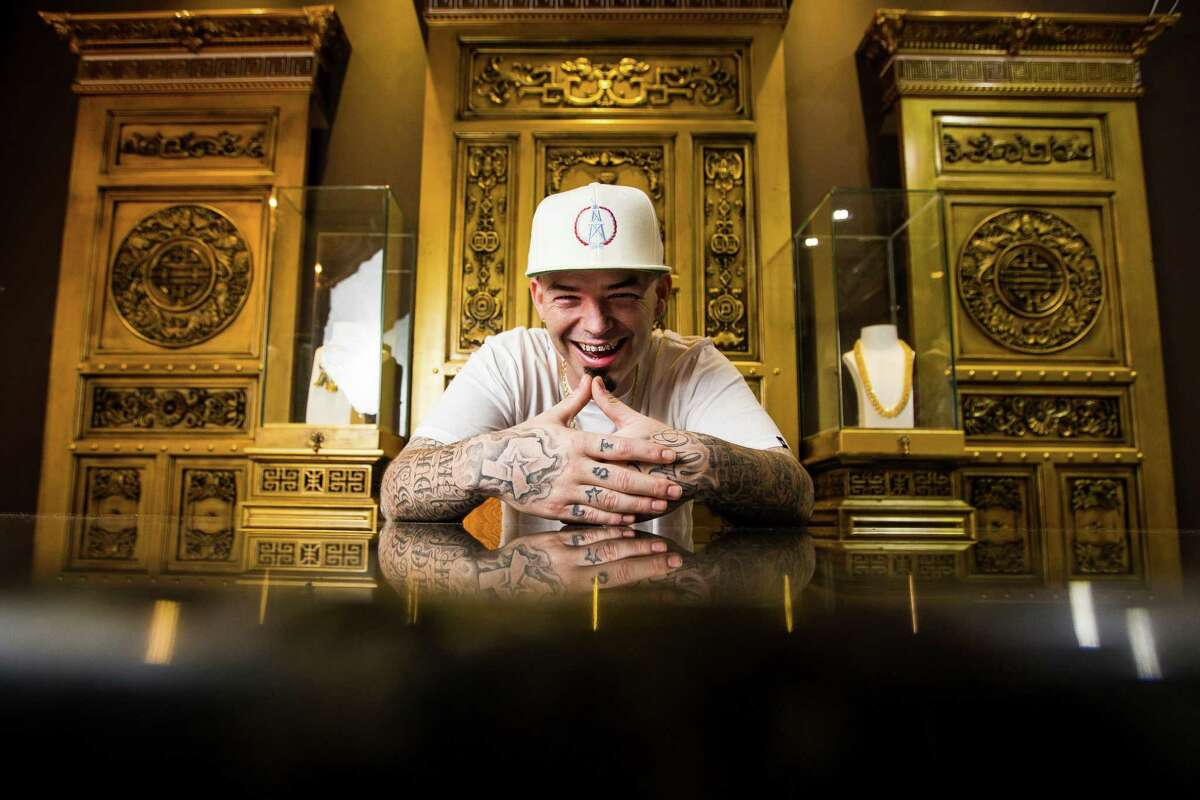 Houston rapper Paul Wall sits behind a desk in the VIP area of his new custom grillz store, Johnny Dang & Co., Tuesday, Oct. 25, 2016 in Houston. ( Michael Ciaglo / Houston Chronicle )