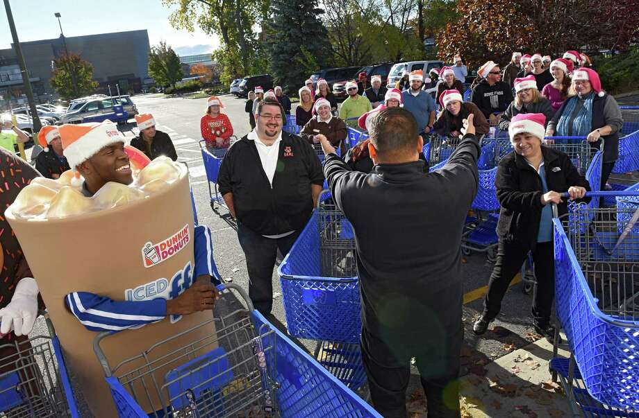 """Marine Gunnery Sgt. (Ret) Albert Roman gives instructions to shoppers as Marine Corps Reserve volunteers and Dunkin' Donuts franchisees celebrate the holiday spirit during a huge shopping spree at Toys """"R"""" Us on Friday, Nov. 4, 2016 in Colonie, N.Y. The shopping spree is the result of a recent $25,000 donation from Dunkin' Donuts to the Toys for Tots Foundation. The donation will be used to fill the Marine Corps Reserve Dunkin' Donuts Toys for Tots Train with gifts and toys for children in need. (Lori Van Buren / Times Union) Photo: Lori Van Buren / 20038681A"""