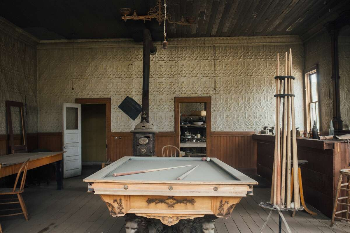An old pool or billiard table in an abandoned saloon in Bodie, California.