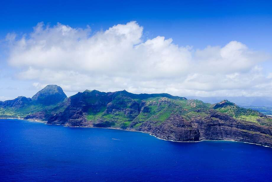 Kauai's rugged cliffs and lush forests beckon to visitors approaching by air. The island is so beautiful, it's not surprising that it was chosen as the setting for many Hollywood films. Photo: Mike Moffitt/SFGATE