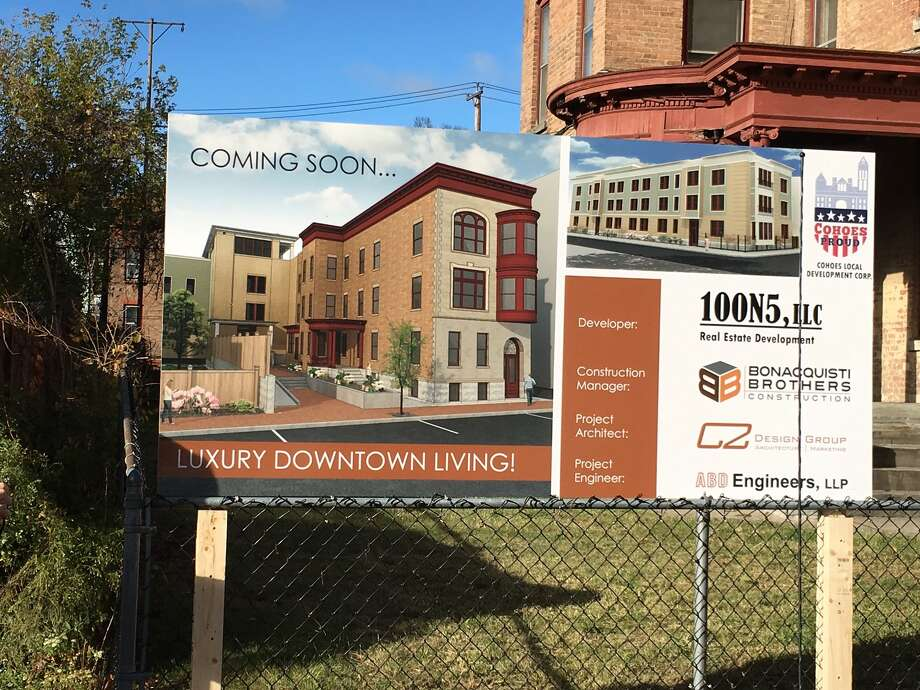 A sign shows renderings of the 26-unit apartment building that developers plan for the former Cohoes Hotel at 134 Remsen St. in Cohoes. The $3 million project is expected to take a year to complete.