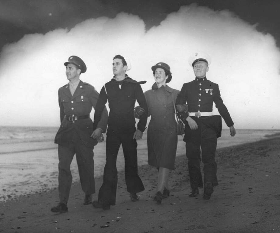 In this World War II recruitment photo, from about 1942, are Fairfielders Ernie Benham, Army; Luke Gilleran, Navy; Dorothy Burns, Women's Army Auxiliary Corps; and Ernest Toth, Marine. Photo: Fairfield Museum Collection / Contributed Photo
