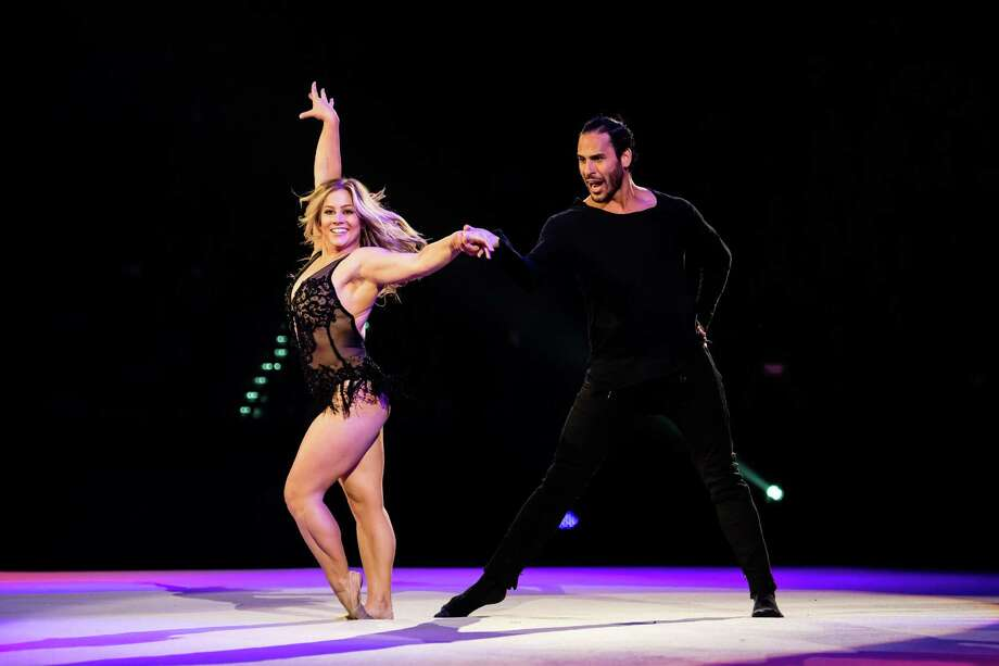 Olympian Gold Medalist Shawn Johnson, with dancer Jaymz Tuaileva, in a scene from the Kellogg's Tour of Gymnastics Champions, which stops Saturday, Nov. 12, at the Webster Bank Arena in Bridgeport. Photo: Kellogg's Tour Of Gymnastics Champions / Contributed Photo