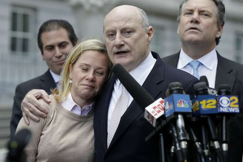 Bridget Kelly is held by lawyer Michael Critchley after she was found guilty in Newark, N.J., of causing traffic jams as a form of political payback. Photo: Julio Cortez, Associated Press