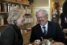 Hillary Rodham Clinton, left, and Mayor Ed Lee, laugh as they and Alice Luong, right, owner of Red Blossom Tea Company share tea at Red Blossom Tea Company in San Francisco on Wednesday. Former Secretary of State Hillary Rodham Clinton visited with Mayor Ed Lee to discuss problems specific to the city in San Francisco, Calif., on Wednesday, May 6, 2015.