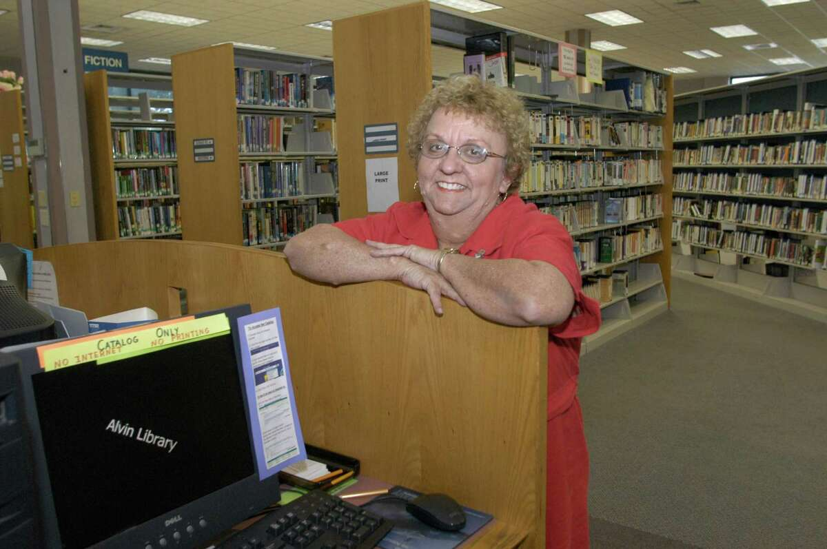 Alvin Public Librarian Danna K. Wilson poses at the library in Alvin.