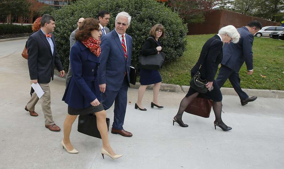Rolling Stone journalist Sabrina Rubin Erdely (front) and Deputy Managing Editor Sean Woods (right) walk with their legal team to federal court this week in Charlottesville, Va. Photo: Steve Helber, Associated Press