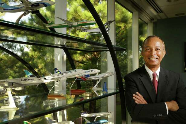 Mario Diaz, director of the Houston Airport System, poses with some of the airline models displayed in his office at 16930 John F. Kennedy Blvd., Friday, Oct. 28, 2016, in Houston. ( Melissa Phillip / Houston Chronicle )