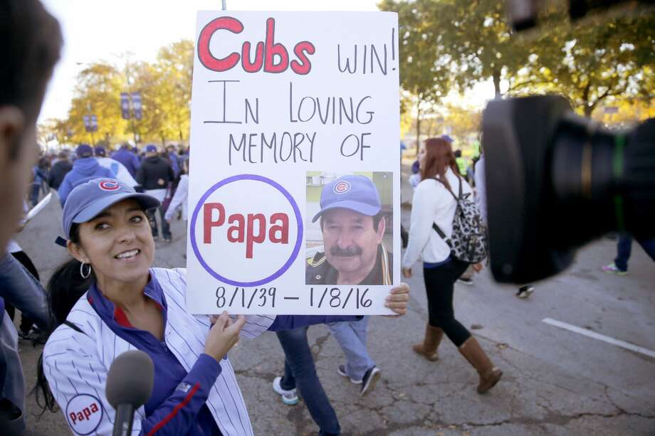 A Chicago Cubs fan is interviewed as she heads to a rally in Grant Park honoring the World Series baseball champions Friday, Nov. 4, 2016, in Chicago. Photo: Charles Rex Arbogast/Associated Press
