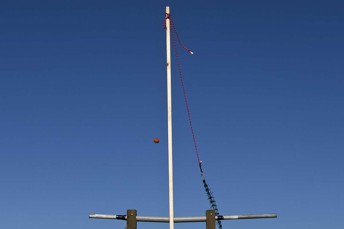 A pumpkin flies through the air on Friday at Bullock Creek's Annual Pumpkin Catapult Competition. Junior physics students designed and constructed trebuchets as part of their class work to see whose pumpkins would catapult the furthest.