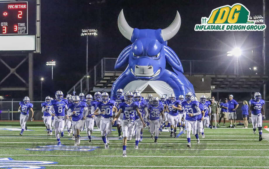 The MacArthur Brahmas take the field through an inflatable mascot tunnel during a recent game. Photo: Courtesy Inflatable Design Group