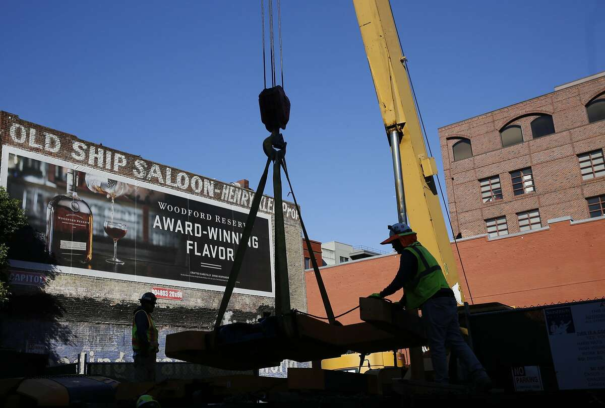 Construction crews work on offloading parts Nov. 4, 2016 used in a drill on the site where pieces from a ship dating back to the late 1800s were previously discovered in San Francisco, Calif.