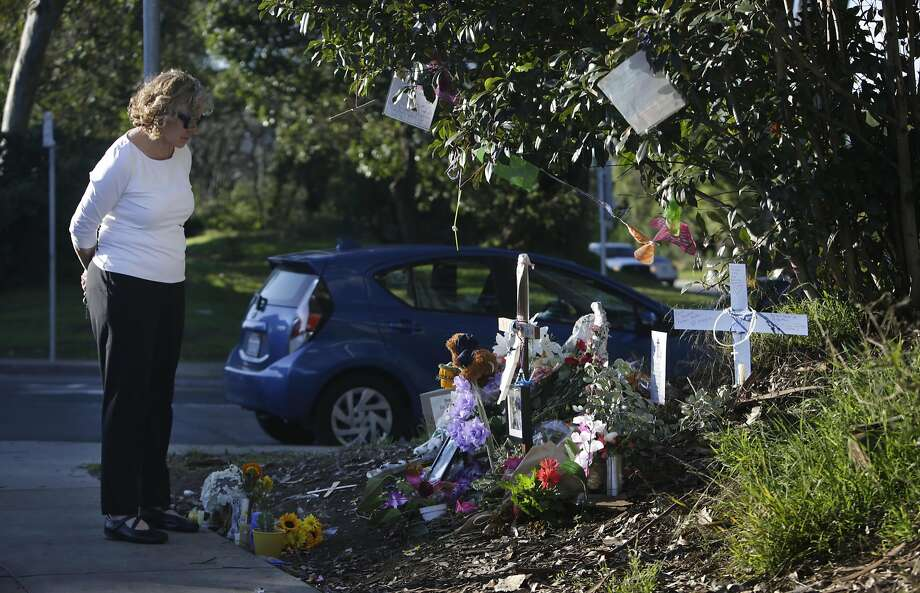 Valerie Raszka, who would regularly see Thomas Hooker, pays her respects at a memorial for Hooker along Funston Avenue on Friday, November 4,   2016 in San Francisco, Calif.  Hooker was homeless, lived on the street for 20 years and died in his sleep at his campsite. Photo: Lea Suzuki, The Chronicle
